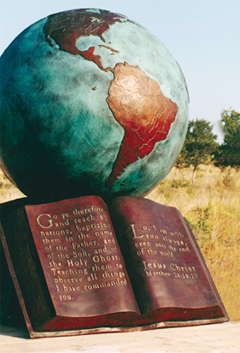 Sculpture of a bible and a globe