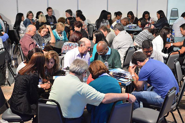 leaders praying at a recent Sepal conference
